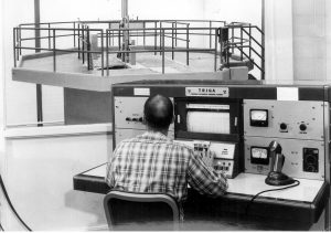 control board with nuclear reactor in background