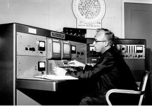 man at a control board