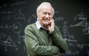 Portrait of Leggett near blackboard