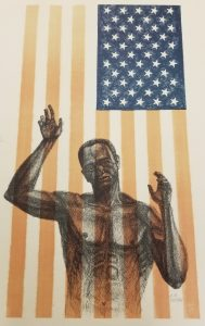 African American Man behind an American Flag hung vertically