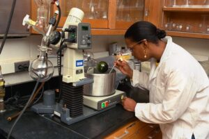 women scientist using a pipet and equipment